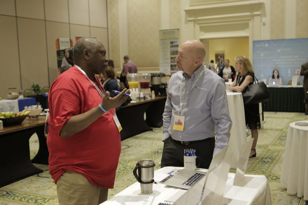 Sam Black shares with an attendee the benefits of Covenent Eyes at the SASH annual conference